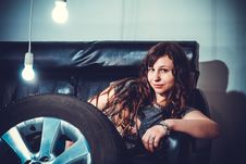 Free Photo Of Woman Sitting On Couch Front Of Wheel Royalty Free Stock Photo - 115977055