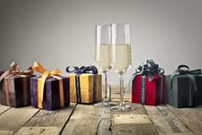 Free Five Assorted-color Gift Boxes And Two Footed Glasses On Top Of Table Stock Photo - 115977060