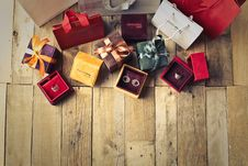 Free Assorted Gift Boxes On Brown Wooden Floor Surface Stock Photos - 115977063