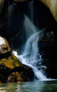 Free Photo Of Running Water Between Brown Rocks Stock Photo - 115977080