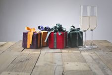 Free Five Assorted Gift Boxes And Two Flute Glasses Stock Images - 115977134