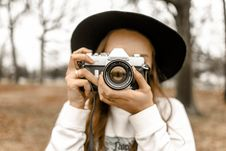 Free Selective Focus Photography Of Woman Using White And Black Slr Camera Stock Photo - 115977170