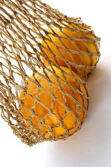Free Two Oranges In String-bag Stock Images - 1169014
