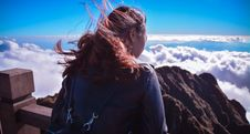 Free Woman Standing Near Cliff Above Clouds Royalty Free Stock Photos - 116049878