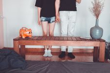 Free Woman And Man Holding Hand Standing Near Brown Coffee Table Inside Room Royalty Free Stock Photo - 116049905