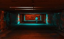 Free Person Wearing Jacket Walking On Tunnel With Red And Green Lights Stock Photos - 116049913
