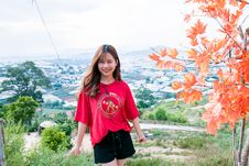 Free Woman In Red T-shirt And Black Shorts Stock Images - 116050024