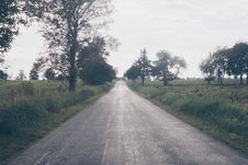 Free Asphalt Road Beside Trees And Grasses Under White Clouds Daytime Stock Photos - 116050053