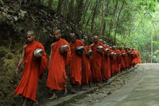 Free Monks Fall Inline On Sidewalk Stock Photography - 116050092