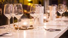 Free Clear Wine Glasses On White Wooden Table Royalty Free Stock Photography - 116147267