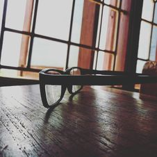 Free Eyeglasses With Black Frames Stock Photography - 116147322