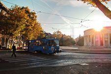 Free Person Wearing Black Walking On Pedestrian Lane Near Blue Tram Train During Sunset Royalty Free Stock Image - 116147376