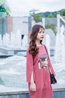 Free Woman Wearing Red Dress Near Fountain Stock Images - 116147384