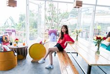 Free Woman In Red Crew-neck T-shirt And Blue Short Shorts Sitting On Bench Stock Photos - 116147413