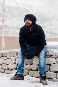Free Man Sitting On Rock Wearing Black Jacket Royalty Free Stock Image - 116147466
