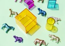 Free Assorted-color Animal Figurines Near Container Royalty Free Stock Photo - 116147505