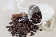 Free Fresh Roasted Coffee Bean Smoke And Spilled From Coffee Cup And Cinnamon On Retro Desk Stock Photos - 116189583