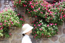 Free Woman Wearing White Bucket Hat With White Top Beside Pink Petaled Flower At Daytime Royalty Free Stock Images - 116232069