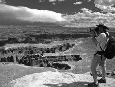 Free Grayscale Photo Of Man Taking Photo Of Canyons Stock Photo - 116232250