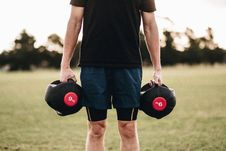 Free Person Holding Black Dumbbells Stock Images - 116232294