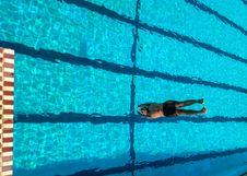 Free Person Diving On Swimming Pool Stock Photos - 116232373