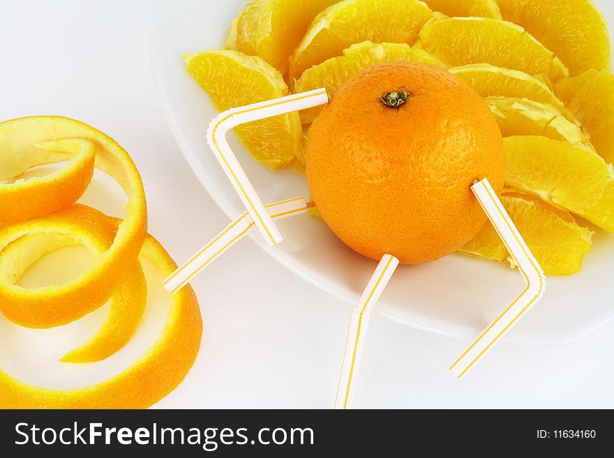 Orange and orange segments on a plate