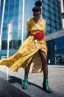 Free Woman Wearing Yellow Floral V-neck Long Dress And Pair Of Green Wedge Sandals Stock Photo - 116371070