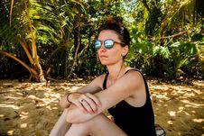 Free Woman In Black Monokini Sitting On Gray Sand Stock Photo - 116371120
