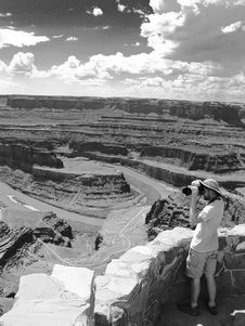 Free Man Standing Holding Camera Near Grand Canyon Grayscale Photo Royalty Free Stock Photography - 116371157