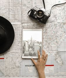 Free Flat Lay Photography Of Person Touching Silver Ipad On World Map Chart Beside Black Hat Stock Images - 116371354
