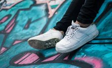 Free Person Wearing Pair Of White Nike Air Sneakers Stock Photo - 116371510