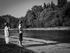 Free Grayscale Photo Of Oy Boy And Girl Standing Near Body Of Water Stock Images - 116371604