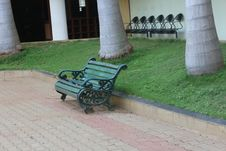 Free Green Metal Bench Beside Concrete Curb And Green Grass Stock Photo - 116433900