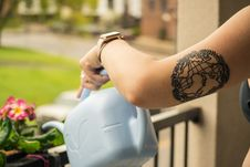 Free Person Holding Gray Plastic Watering Can Stock Photo - 116504380
