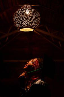 Free Woman Looking Upwards Toward Pendant Lamp Stock Photography - 116504442