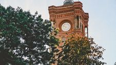 Free Clock Tower Near Trees At Daytime Photo Royalty Free Stock Photos - 116504508