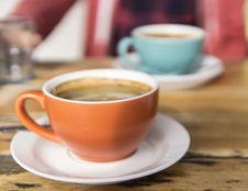 Free Shallow Focus Photo Of Orange Ceramic Mug On White Saucer Stock Photography - 116504542