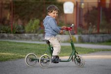 Free Boy Riding Green Bike Stock Photo - 116504550
