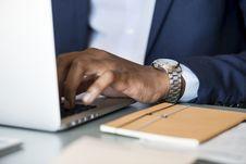 Free Photo Of Person Wearing Gray Analog Watch Tapping Keyboard Of Laptop Stock Image - 116504621