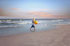 Free Boy Holding Ball Near Body Of Water Royalty Free Stock Photography - 116504647