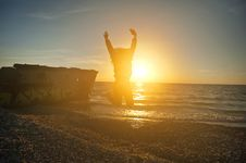 Free Person Jumping On Seashore During Golden Hour Royalty Free Stock Images - 116504669