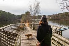 Free Woman Walking On Dock With Dog Stock Photography - 116504682