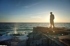 Free Silhouette Photo Of Man Standing Near The Edge Of Concrete Pavement Stock Image - 116504751