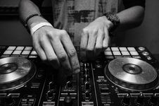Free Grayscale Photography Of Person Using Dj Controller Stock Photos - 116504853