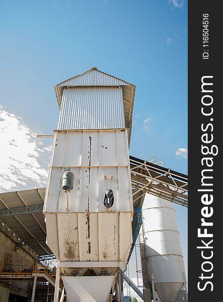 White G.i Sheet Tower Under Blue Sky
