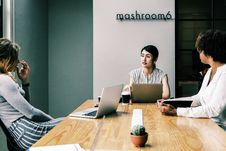 Free Three People Discussing Inside The Conference Room Royalty Free Stock Images - 116695149