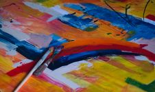 Free Two Paintbrushes On Multicolored Abstract Painting Stock Photography - 116695172