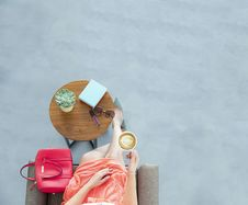 Free Woman Wearing Peach Skirt Sitting On Sofa Chair Holding A Cup Of Coffee Stock Image - 116695401