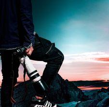 Free Man Wearing Black Bomber Jacket And Denim Jeans Holding Dslr Camera Stock Photos - 116695573