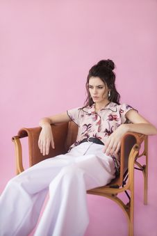 Free Photography Of A Woman Sitting On Chair Stock Images - 116695644